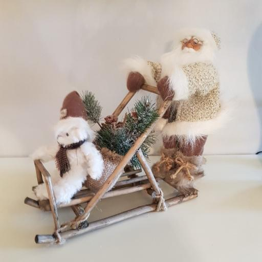 Santa Light Brown pushing Sleigh 13020 - Flame