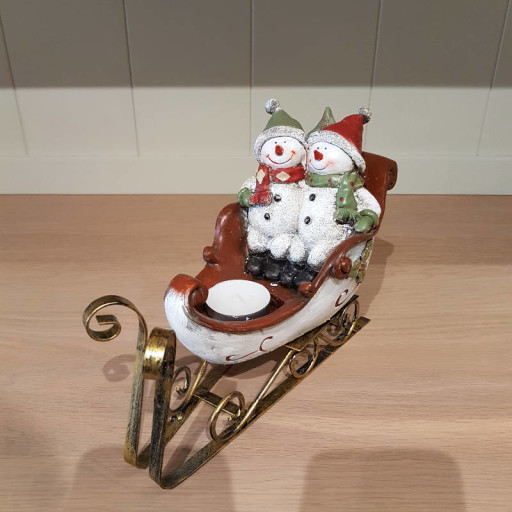 Snowman-couple-on-sleigh.jpg